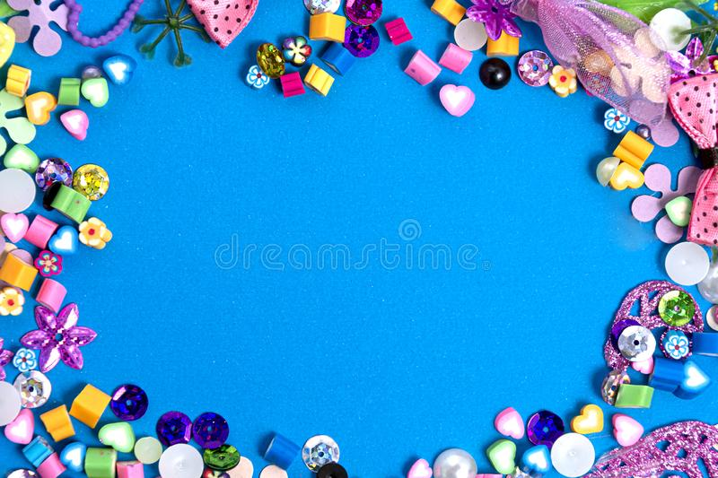 Mix of beads and beads on a blue background. The formation border is a frame with a blue color for the text. Mockup and abstract, royalty free stock photo