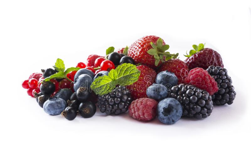 Mix berries isolated on a white. Ripe blueberries, blackberries, red currants, black currant, raspberries and strawberries. stock image