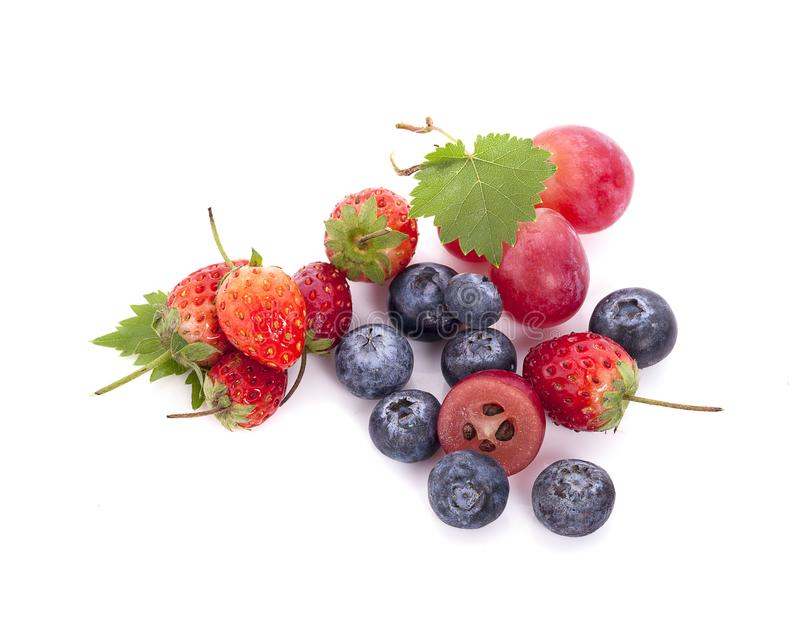 Mix berries isolated on a white. Ripe blueberries, red currants, raspberries and strawberries. Various fresh summer berries on stock images