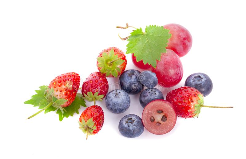 Mix berries isolated on a white. Ripe blueberries, red currants, raspberries and strawberries. Various fresh summer berries on stock image
