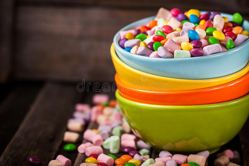 Mix of candies in a bowls stock photo