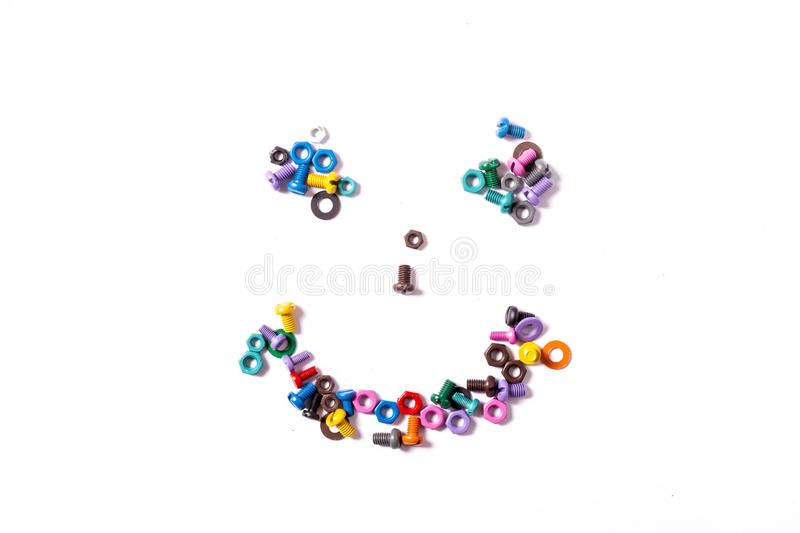 Mix of color nuts and bolts. On white background royalty free stock image