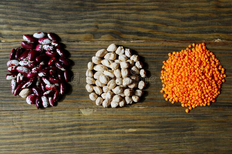 Mix of colorful beans on brown wooden background, horizontal view. Food background. Mix of colorful beans on brown wooden background, horizontal view. Healthy stock image