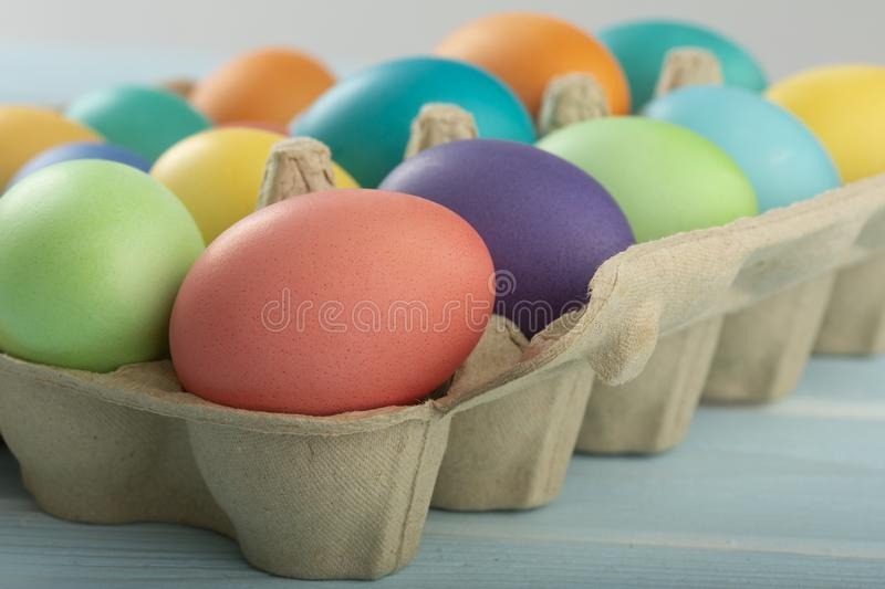 Mix of colorful and bright Easter chicken eggs in a box stock image