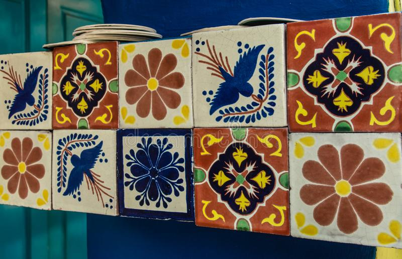 Mix colorful ceramic tiles on the wall closeup view stock images