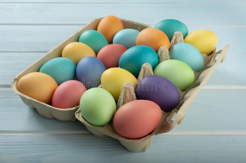 Mix of colorful chicken eggs in a carton stock image