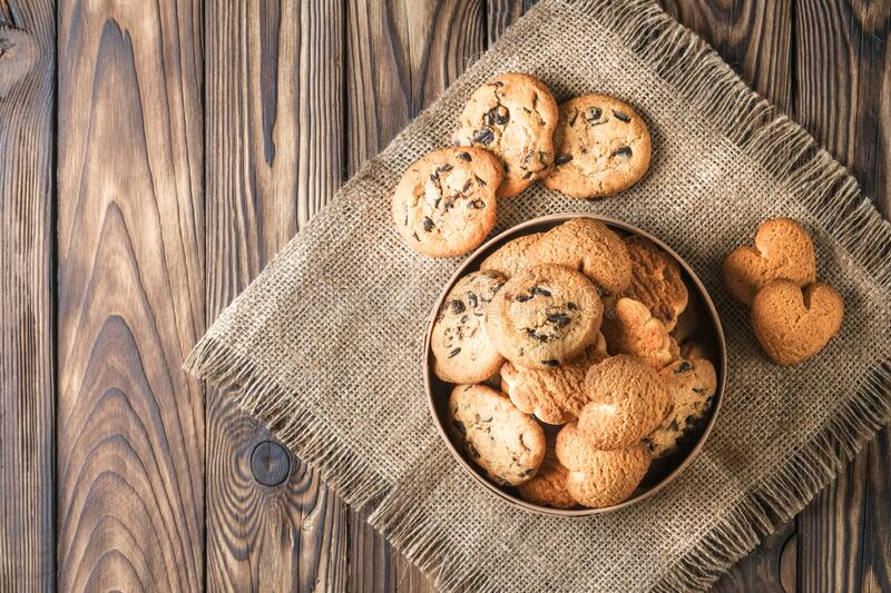 Mix of cookies in a wooden box. On rustic background copy space stock photos
