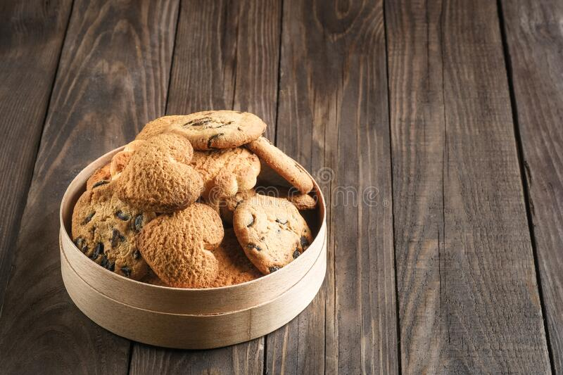 Mix of cookies in a wooden box. On rustic background copy space stock images