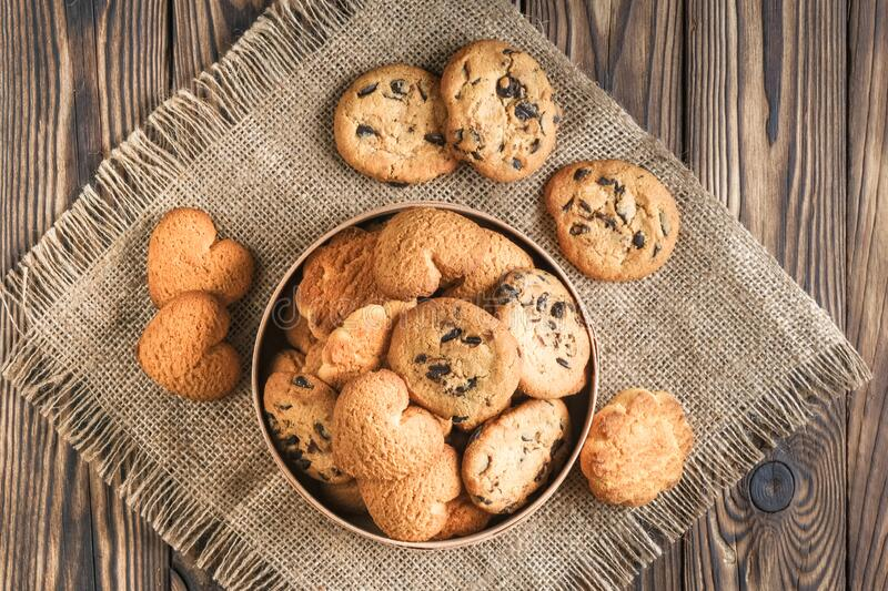 Mix of cookies in a wooden box. On rustic background copy space stock photography