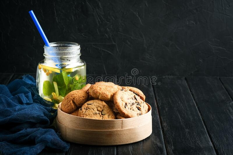 Mix of cookies in a wooden box. On rustic background copy space stock photo