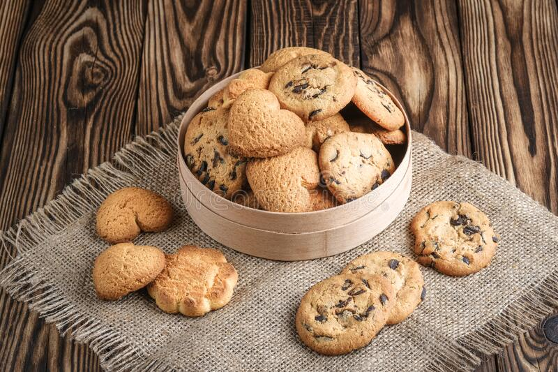 Mix of cookies in a wooden box. On rustic background copy space royalty free stock photos