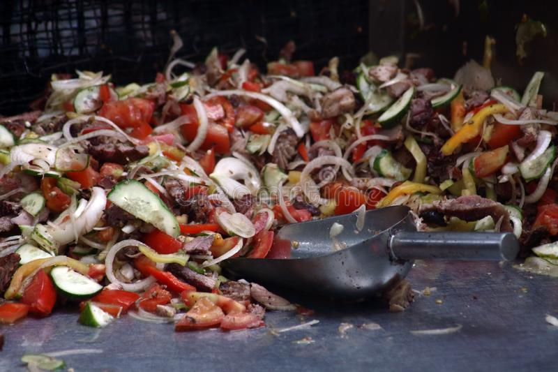 Mix of cut meat and vegetables - ingridients for doner kebab stock images