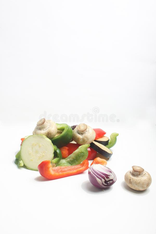 Mix of cut vegetables isolated on white background royalty free stock photography
