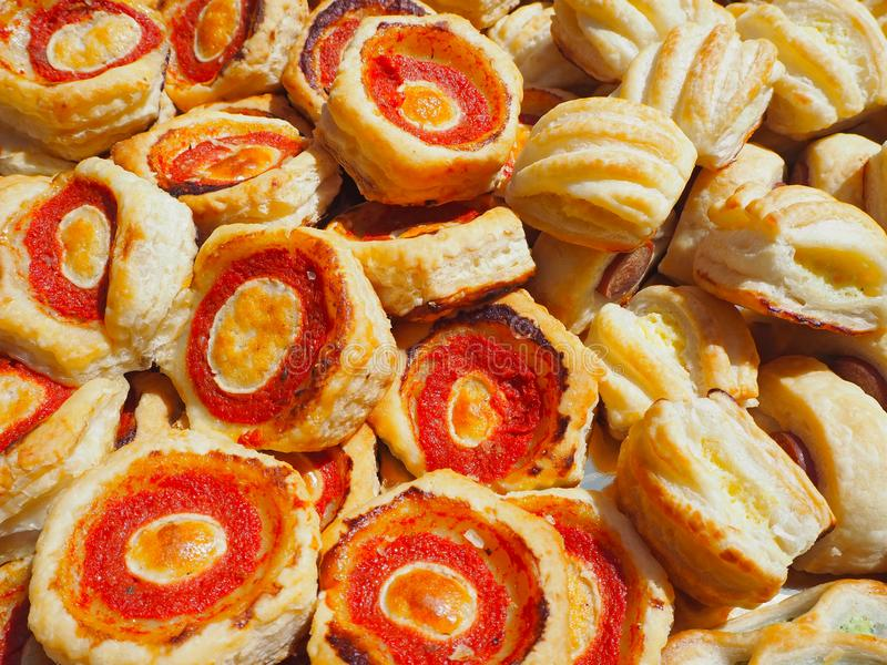 Mix of delicious appetizers and small pizzas made of puff pastry stock photo