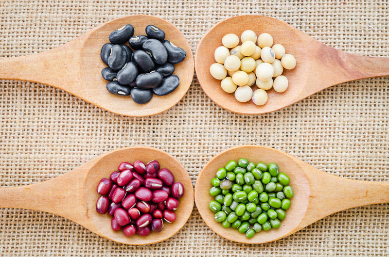 Mix from different beans on sack background. royalty free stock image