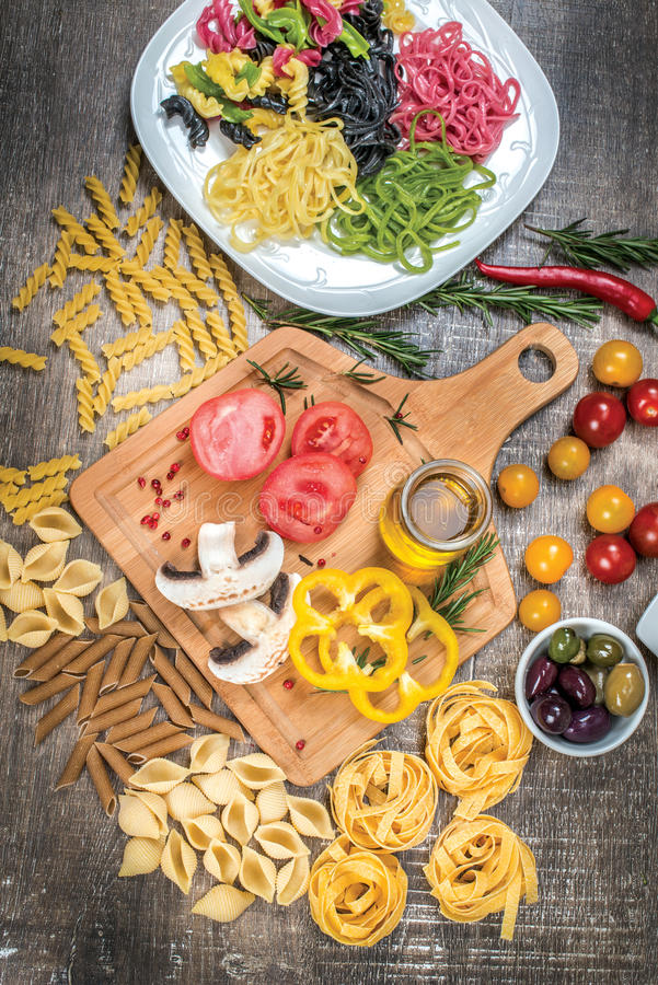 Mix different colored raw whole grain pasta and noodles. Organic stock images