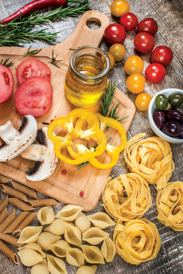 Mix different colored raw whole grain pasta and noodles. Organic stock photos