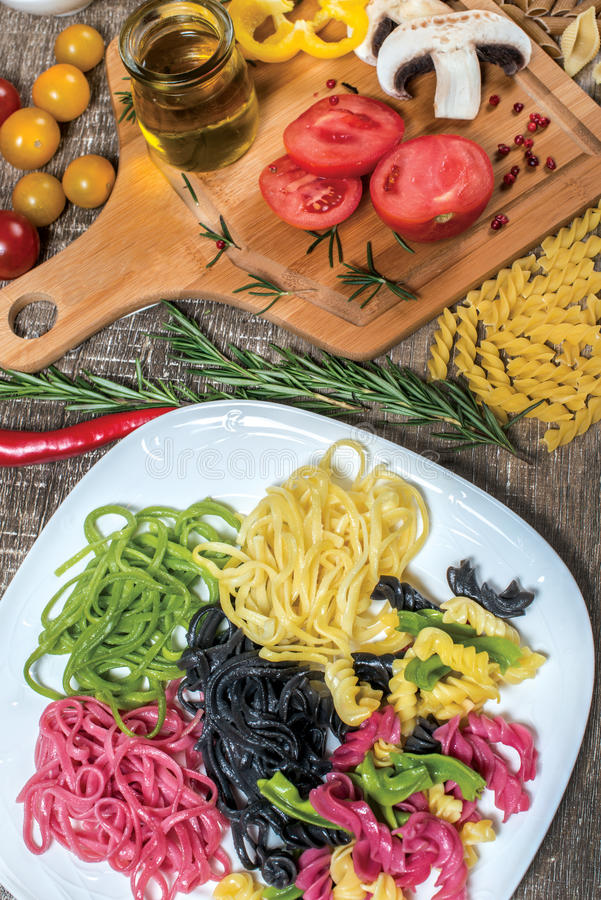 Mix different colored raw whole grain pasta and noodles. Organic stock photo