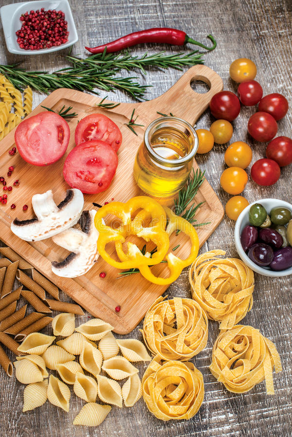 Mix different colored raw whole grain pasta and noodles. Organic royalty free stock images
