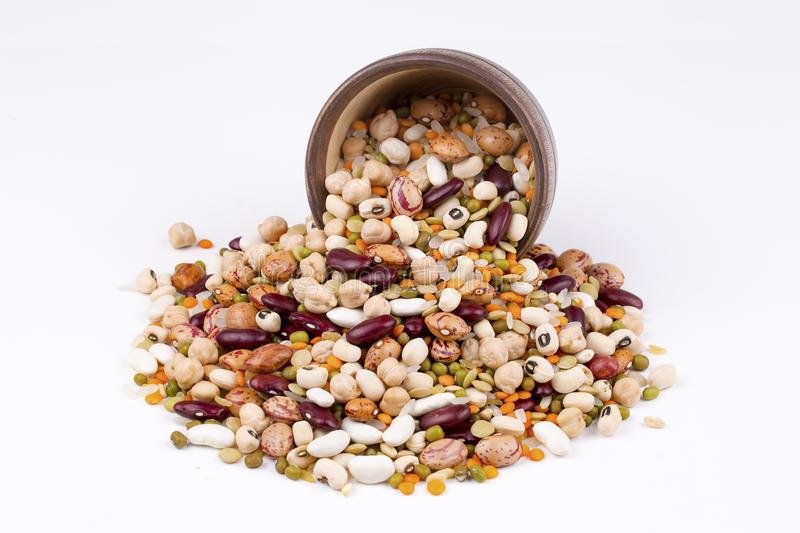 Mix dried legumes. Collection set of beans, legumes, peas, lentils on ceramic bowl on white wooden background stock photography