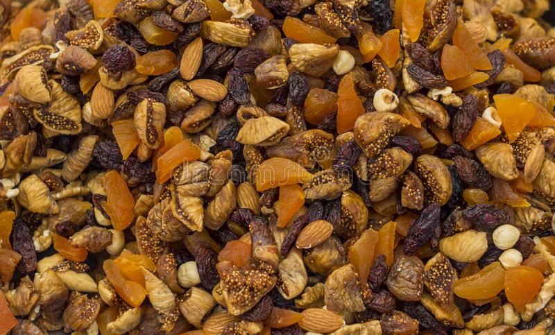 Mix of dry nuts and fruits close up. royalty free stock images