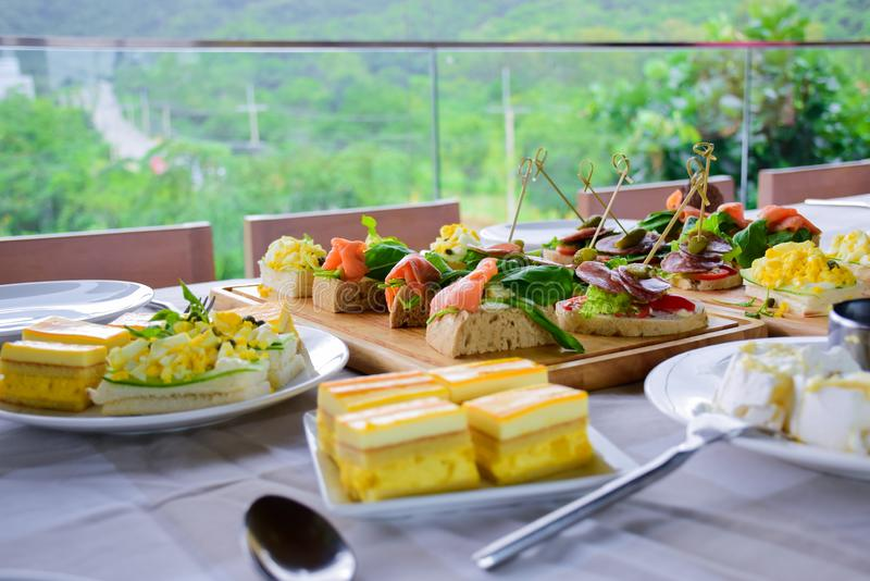 Mix food on dinner table, appetizer and dessert royalty free stock photography