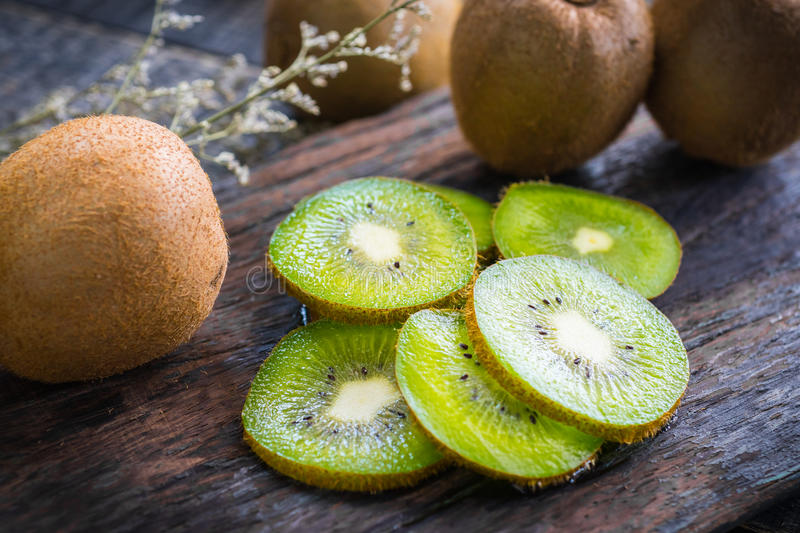 Mix of fresh fruits For good health . Kiwis , red grapes and Or stock image
