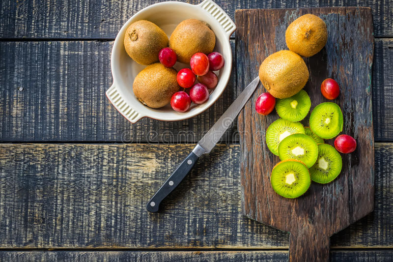 Mix of fresh fruits For good health . Kiwis , red grapes and Or stock photography