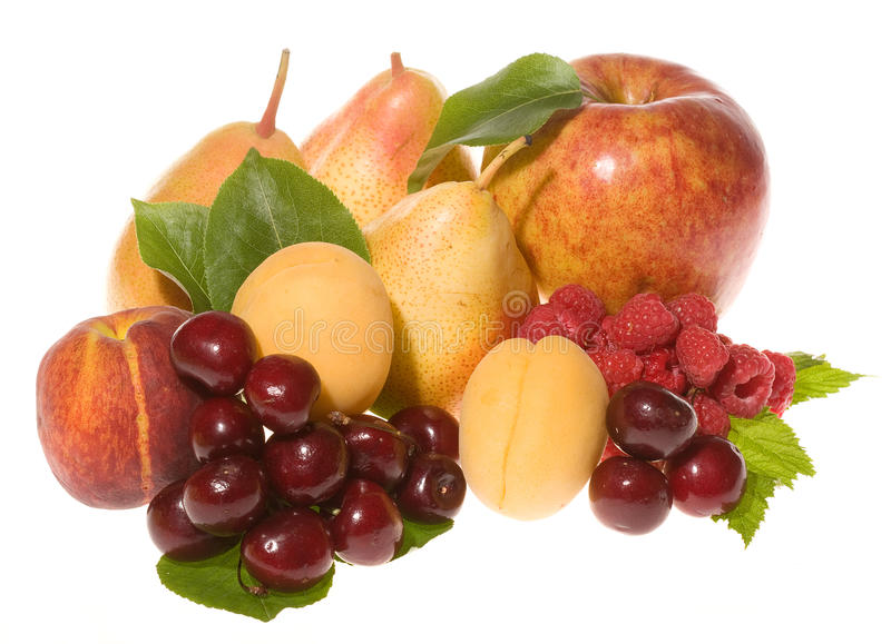 Mix of fresh fruits with leafs. On white background stock image