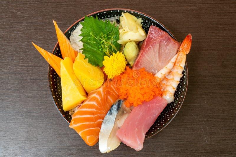 mix fresh raw on topped rice bowl (donburi stock photo