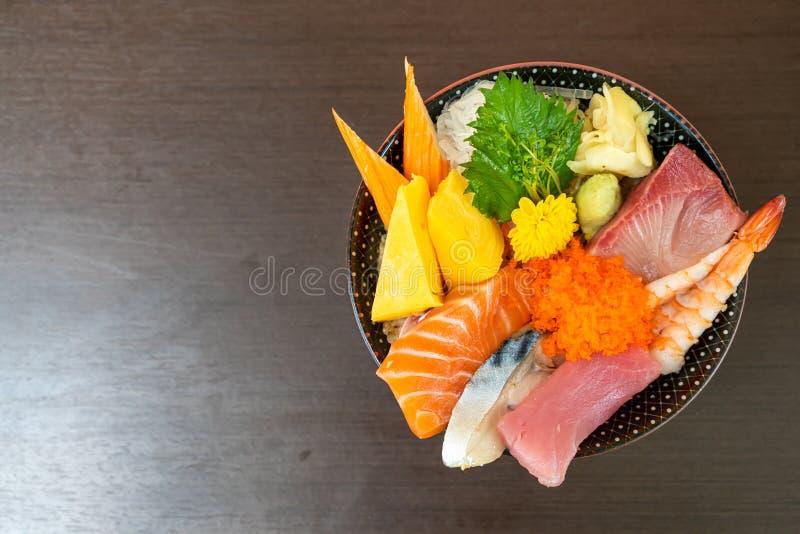 Mix fresh raw on topped rice bowl (donburi. ) - Japanese food style royalty free stock photography