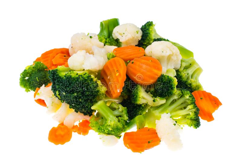 Mix of frozen summer vegetables in heap isolated on white background royalty free stock photography