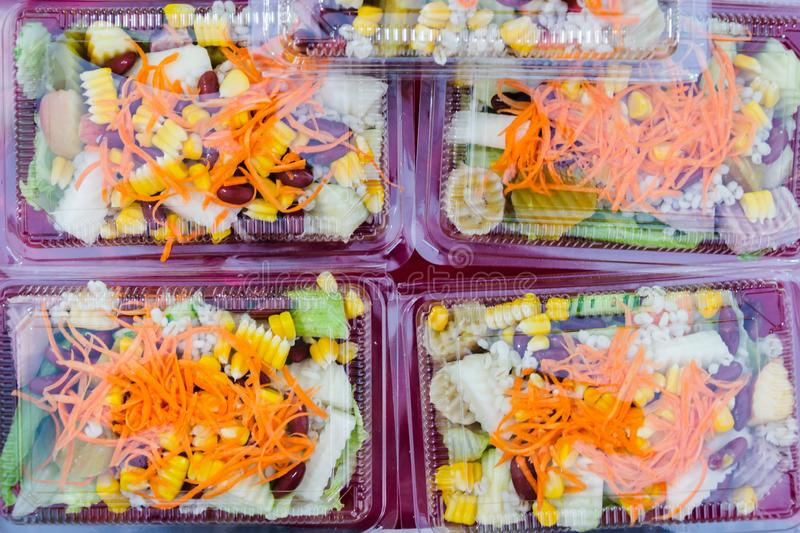 Mix fruit and vegetable salad in plastic package stock photos