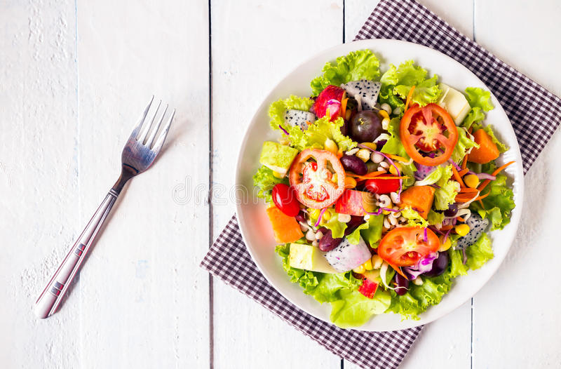 mix fruit and vegetable salad stock photo