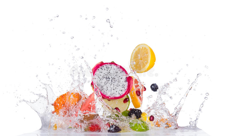 Mix fruit in water splashes on black background stock photo