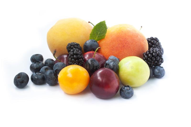 Mix of Fruits Apricots Blueberries blackberries plums. Isolated on white background royalty free stock images
