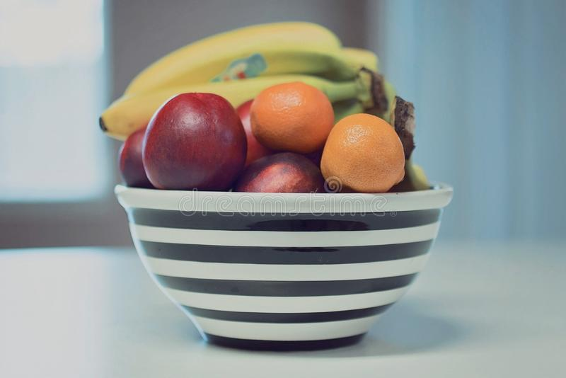 Mix fruits in black bowl royalty free illustration