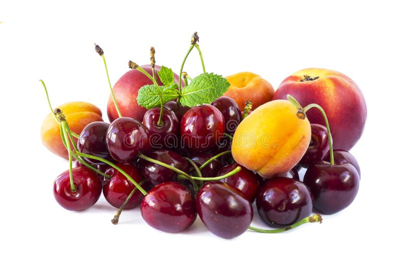 Mix fruits isolated on white background. Ripe cherries, apricots and nectarines. Sweet fruits with copy space for text. Various fr stock image
