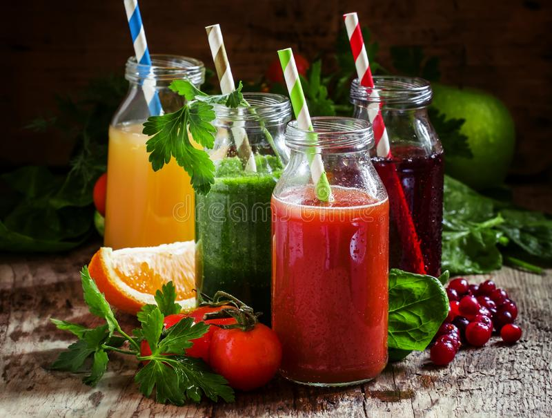 Mix of healthy fruit and vegetable juices in small bottles with royalty free stock photos