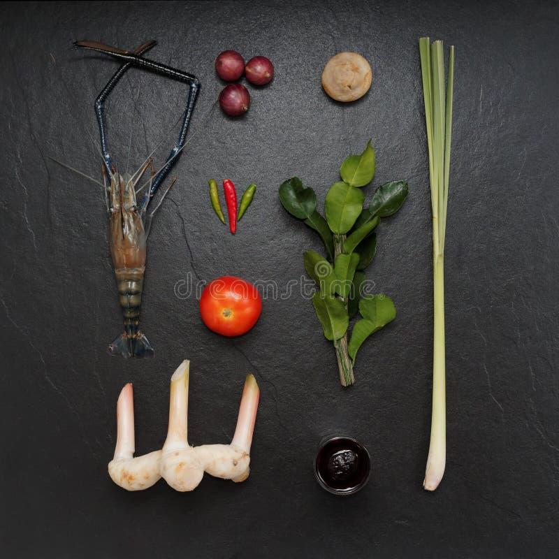 Mix ingredients of tom yum, shrimp, lime, shallot, mushroom, tomato, bergamot leaf, lemongrass, galangal, chili paste royalty free stock photo