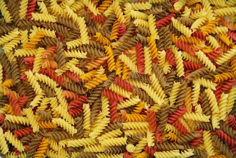 Mix of multicolored fusilli pasta royalty free stock photos