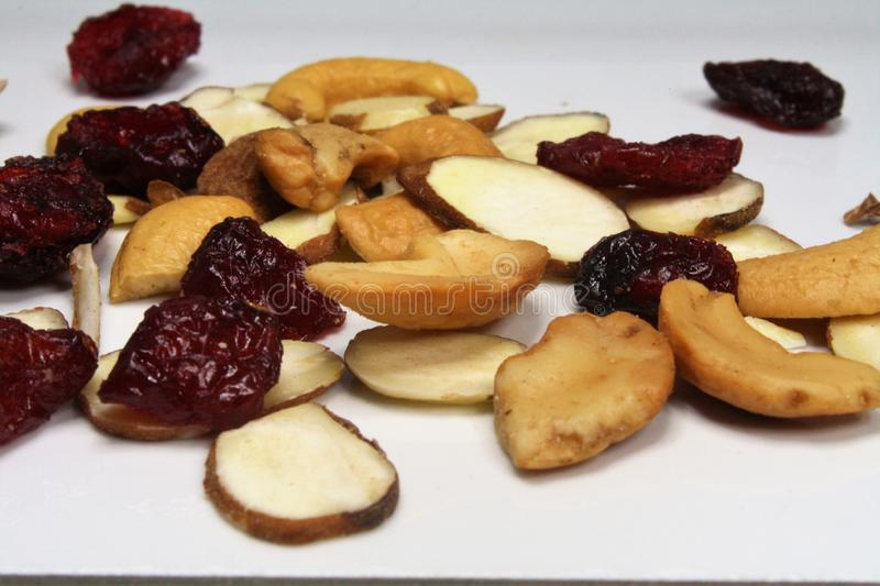 Mix of nuts, almonds and cranberries stock photography