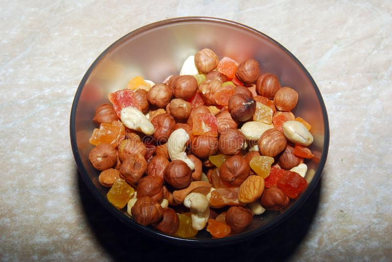The mix of nuts and the candied fruit royalty free stock photo