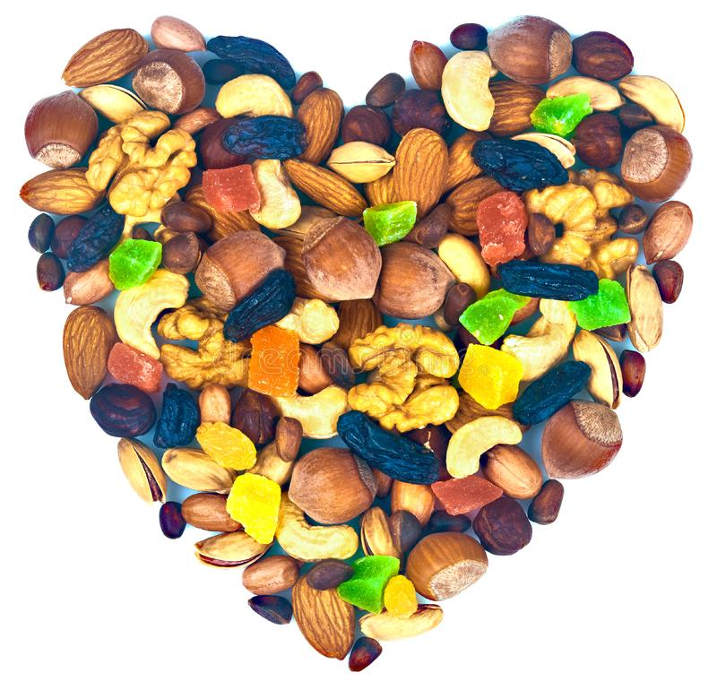 Mix nuts and dried fruits in the form of a heart. Mix nuts and dried fruits isolated in the form of a heart royalty free illustration