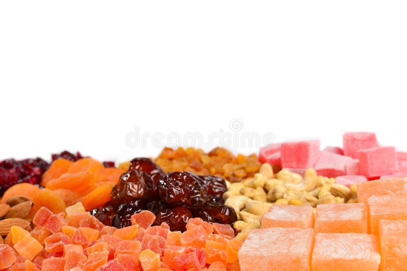 Mix of nuts and dried fruits and sweet turkish delights background. Top view stock photography