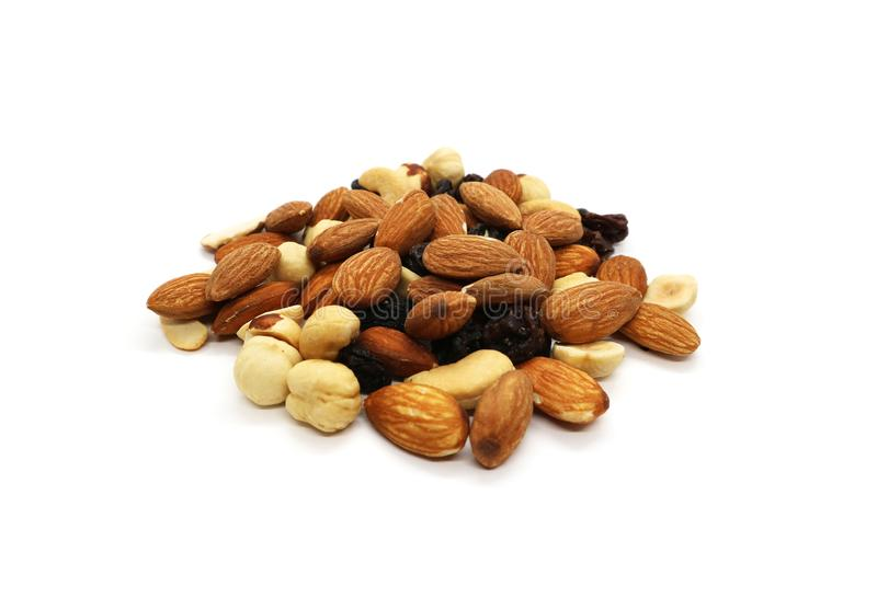 Mix of nuts hazelnut almonds and cashews with raisins, a bunch isolated on a white background royalty free stock image