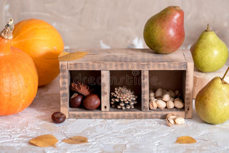 Mix of nuts: pistachio, almonds, hazelnut, peanuts in vintage wooden box on rustic wooden background. Top view. Raw healthy food. royalty free stock photos