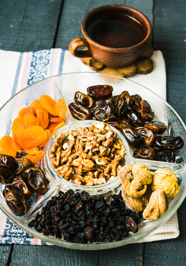 Mix of organic dried fruit. Dates, figs, raisins, dried apricots royalty free stock photography