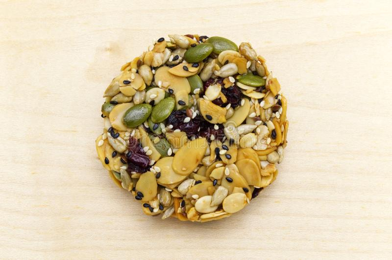Mix organic whole grains energy cookie on wooden background. stock photo
