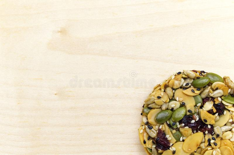 Mix organic whole grains energy cookie on wooden background. royalty free stock image